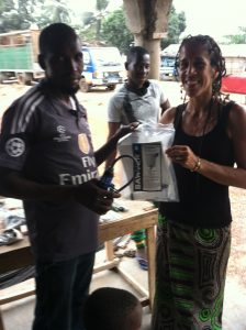 Vice President Michal Anna Carrillo distributing a waves for water clean water filter!